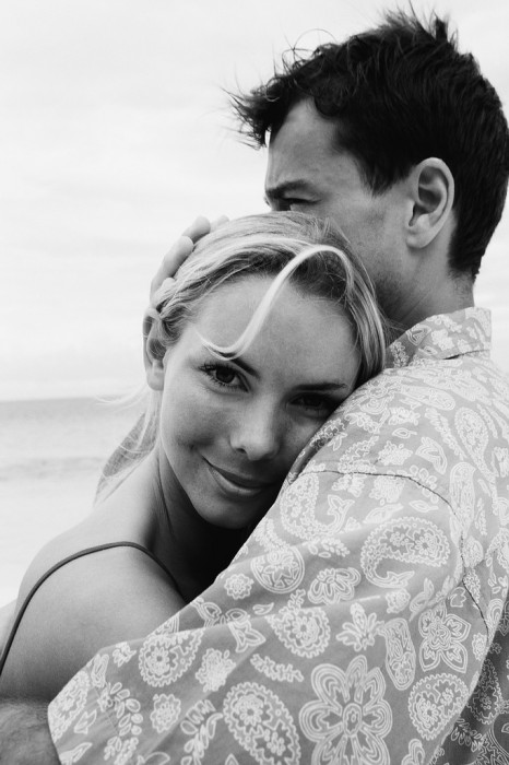 Couple Hugging and Happy at the Beach